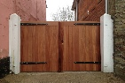 Sapele hardwood gates treated brown