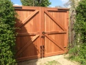 Rear view of sapele hardwood gates, treated brown, rear view