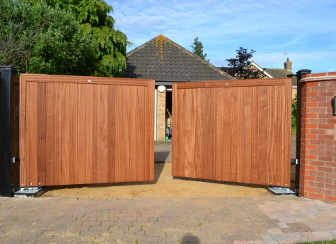 Sapele Classic gates, brown treated on underground automation system