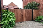 Custom sapele hardwood gates treated brown