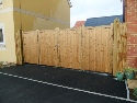 Softwood bifolding gates treated brown