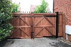 Sapele hardwood gates treated brown, rear view